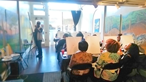 A painting class at Paint The Town art gallery at 74 Allen St.