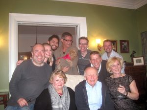 Terrence McNally (seated center) at the house party with the It's Only a Play cast and friends