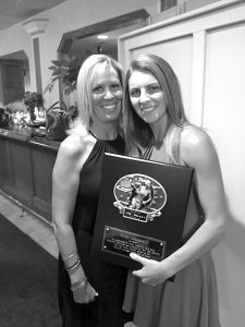 """Riley Lucarelli (r) of Lancaster High School stands with her mother Josette after receiving the girls """"Ox"""" award on Monday night at the Tom Borrelli Awards dinner at DiPaolo's Restaurant. The award is presented to seniors who display the talent, versatility, hard work, dedication and toughness displayed by Borrelli in his work as a reporter and editor at the Buffalo News. Carter Stefaniak of St. Joe's was the boys winner of the """"Ox"""" award."""