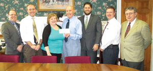 Photo courtesy NorthCountryNow.com Craig Chevalier and Michael Thayer, Greater Ogdensburg Chamber of Commerce board members; Laura Pearson, chamber executive director; Preston Carlisle, Edward Betz and Lloyd Grandy, partners, Carlisle Law Firm; and Sean McNamara, chamber president.